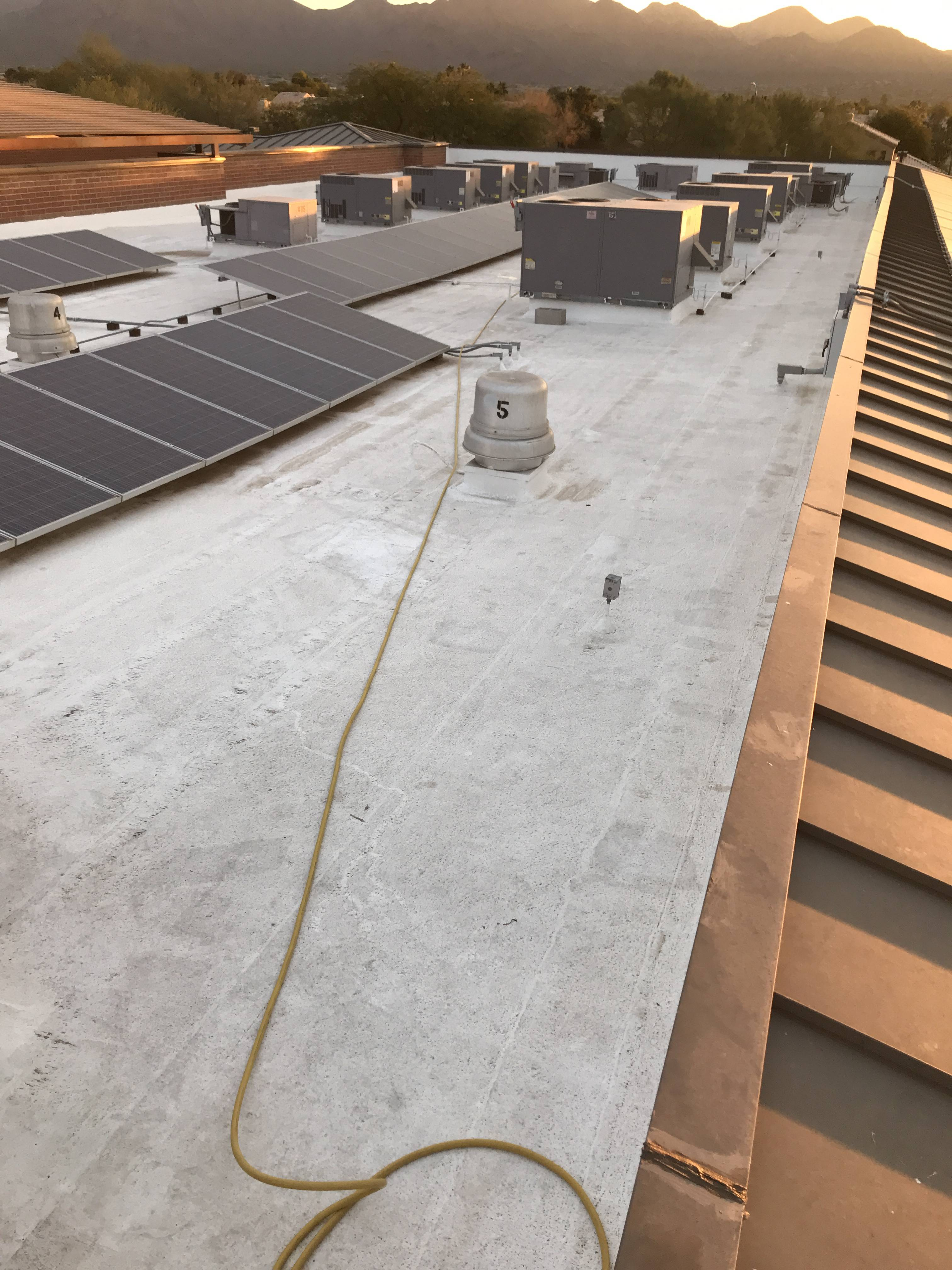 Roof repair on a Scottsdale Roofing Company Headquarters